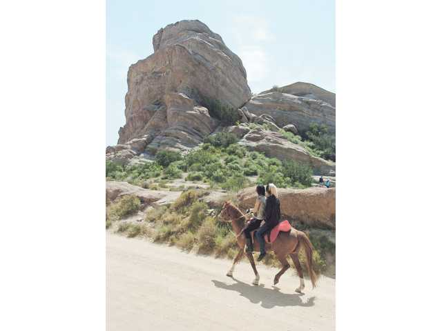 Horseback riders explore the trails at picturesque Vasquez Rocks Natural Area in Agua Dulce. Easy to moderate trails are also available for hikers, and leashed dogs are welcome.