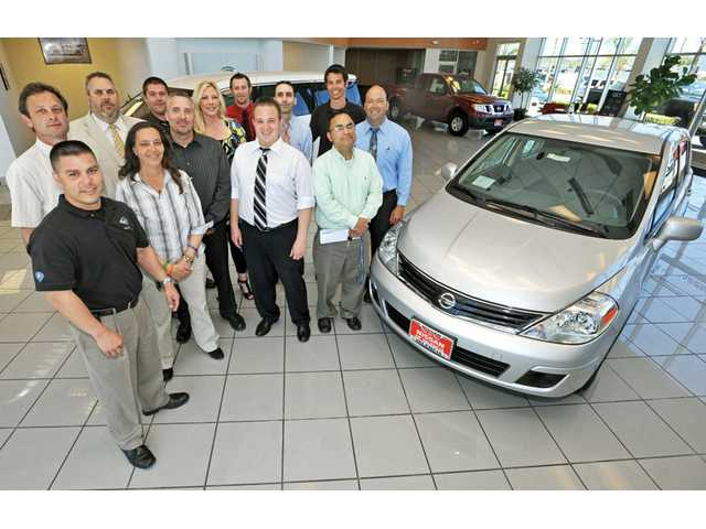 General Manager Dan Sterkel, back row, second from left, and his team at Nissan of Valencia.