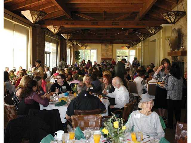 Guests mingle and enjoy breakfast at Robinson Ranch Country Club in Canyon Country.