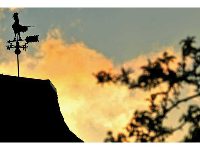 A weather vane is perched on a rooftop in Newhall at sunset Thursday. Santa Clarita got a cornucopia of winter weather Friday, as hail, rain and light snow fell sporadically in the area. Saturday saw clearer skies, but the chilly weather remained. The forecast calls for highs in the low-70s and sunny skies over the Santa Clarita Valley by Tuesday.