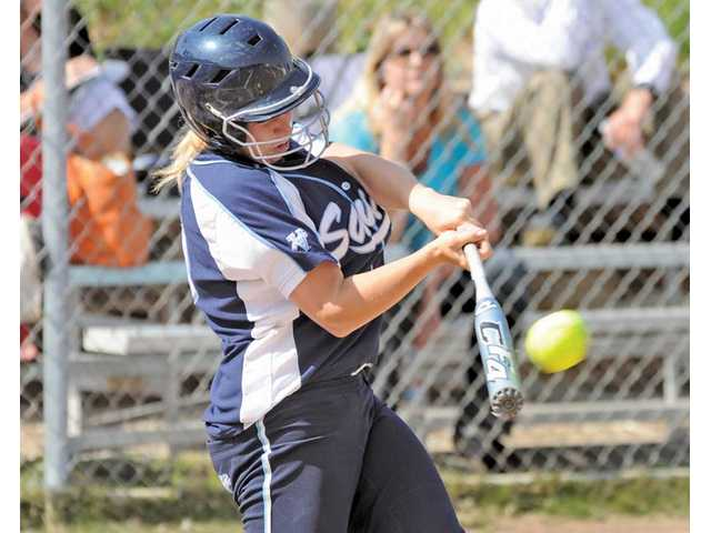 Saugus catcher Ashley Butera hits a three-run home run against West Ranch on Tuesday at Saugus High.
