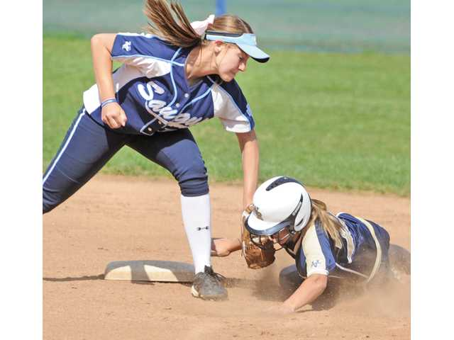 Saugus shortstop Jenna Kelly, left, makes a tag on West Ranch's Mollie Sorenson as she slides into second base during the first inning on Tuesday at Saugus High School.