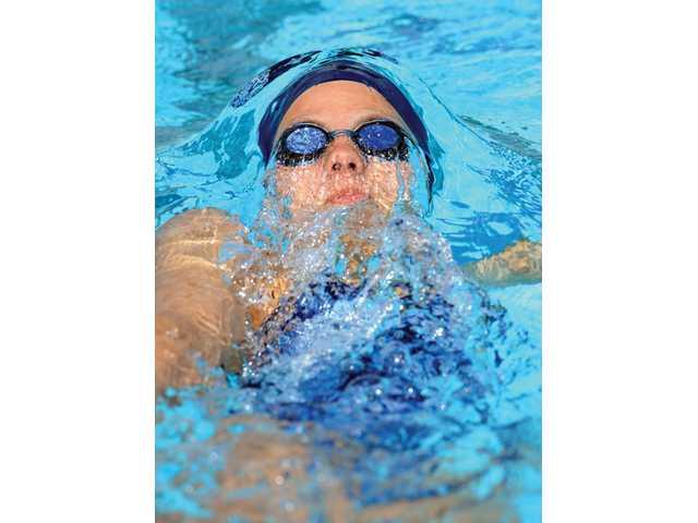 Saugus' Caitlin Baker swims the 200-yard individual medley on Wednesday at the Santa Clarita Aquatic Center.