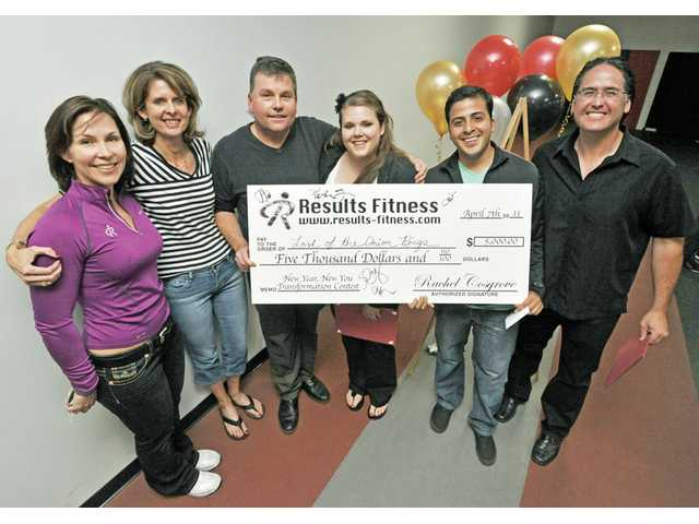 Rachel Cosgrove, left, with the winning  Results Fitness New Year, New You Transformation contest Lord of the Onion Rings team of Amy Grant, Anders Lindborg, Jessica Johnson, Sem Martinez and Hector Quinonez.