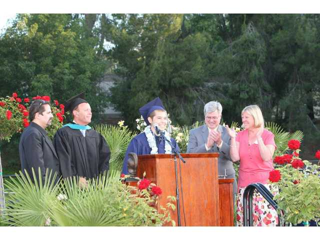 Jonathan Borondy speaks at a graduation ceremony at Saugus High School.