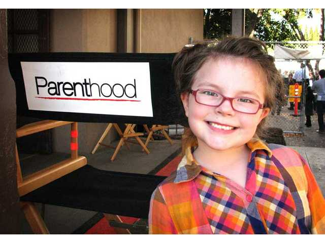 "Marlowe Peyton, pictured here on the set of ""Parenthood,"" is one of two Newhall girls who is set to receive a C.A.R.E. award on April 30 at Universal Studios Hollywood."