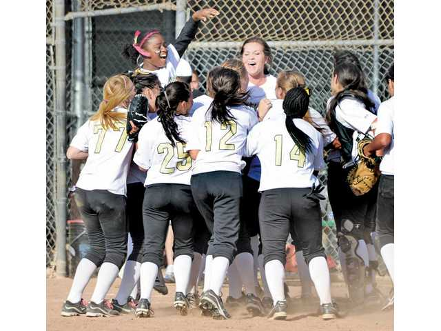 The Golden Valley softball team celebrates after a 4-3 victory over Canyon at Golden Valley High on Thursday. It was the team's first Foothill League victory since April 15, 2008.