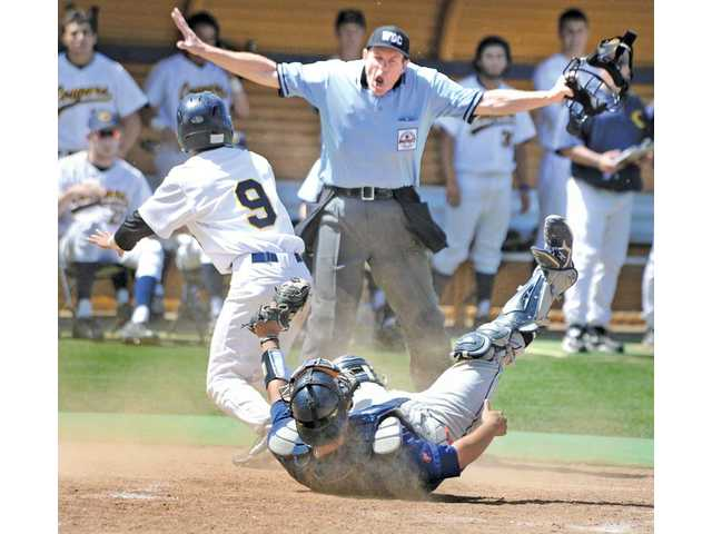 Home base umpire Larry Davis, center, calls College of the Canyons baserunner Kasey Toven (9) safe at home after colliding with Citrus College catcher Nicholas Bergara (12) in the fifth inning at COC on Saturday. The Cougars won 3-2.