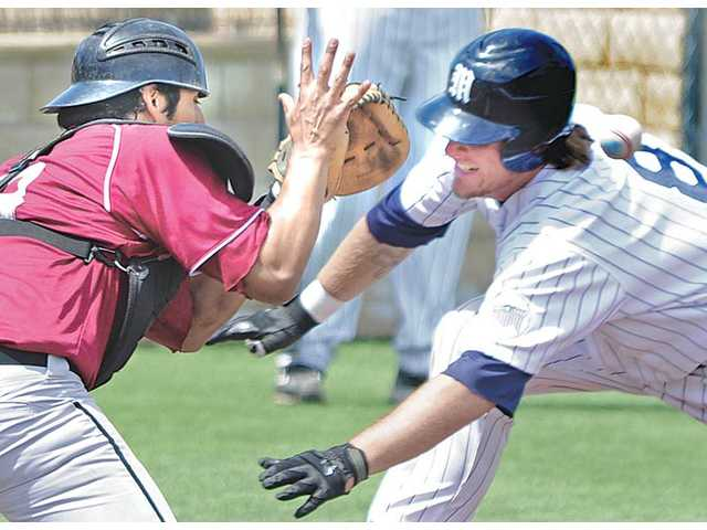 The Master's College's J.T. Adams, right, beats the throw to Azusa Pacific catcher Anthony Delgado, left, during a doubleheader at Reese Field on Saturday. TMC won both games.