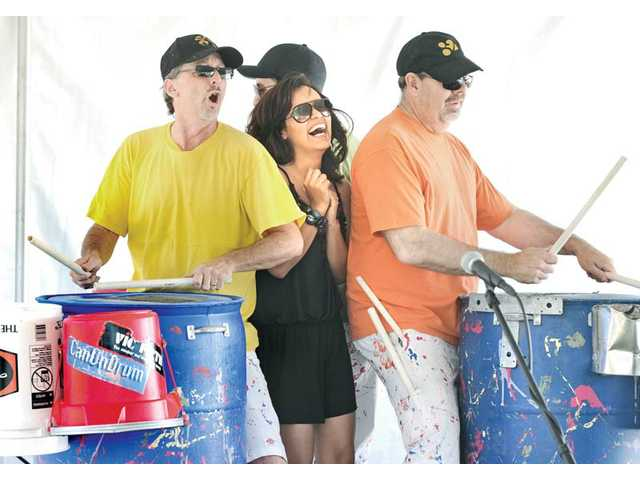 Jackie Major, center, of Canyon Country, laughs as she joins Jeff Sallee, left, and Mark Schnose of the percussion group CanUnDrum. The performance was held at the 2011 City of Santa Clarita Earth Arbor Day Festival held at Central Park in Saugus on Saturday.
