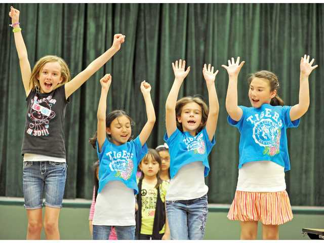 "Students rehearse a cheer for ""Elementary School: The Musical"" at the Stagecraft After School Enrichment program at Fair Oaks Ranch Community School in Canyon Country."