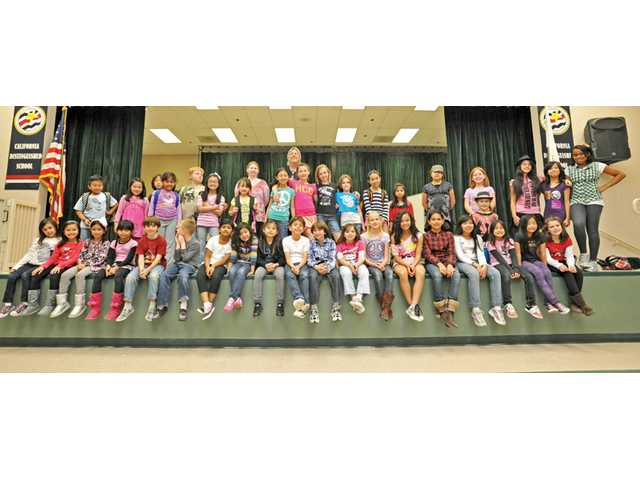 There were 40 children in the spring Stagecraft program, shown here with co-director Dennis Poore, top center.