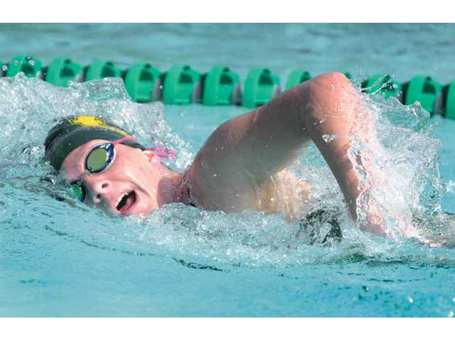 Canyon's Megan Warr wins the 500-yard freestyle on Wednesday at the Santa Clarita Aquatic Club.