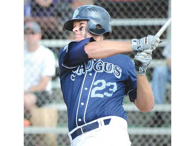Saugus left fielder Justin Sheehan slugs a home run in the third inning against Hart at Hart High on Friday.