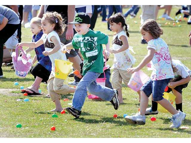 A group of children run to collect the eggs at the event on Saturday.