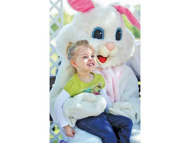 Taylor Dice, 3, of Saugus, smiles whil having her photo taken with the Easter bunny at Central Park.