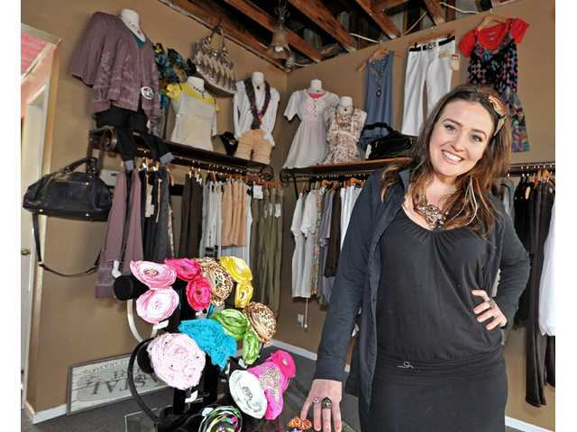 Madison Schwartz, owner of Fresh Boutique, stands inside her Newhall retail store on Wednesday