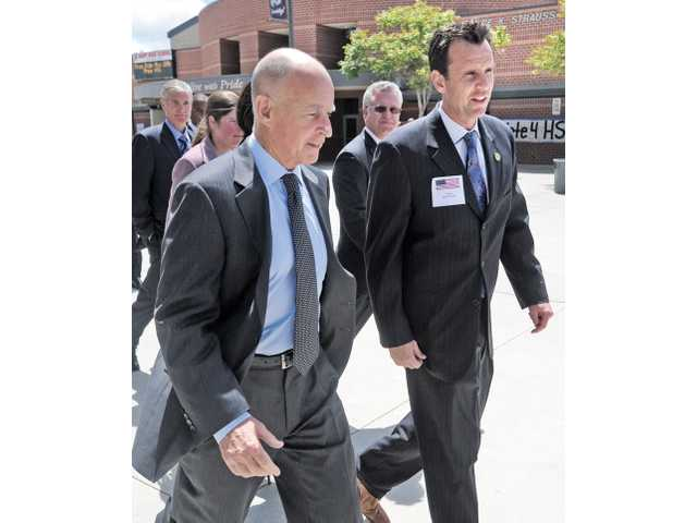 Gov. Jerry Brown, left, and Assemblyman Cameron Smyth, R-Santa Clarita, walk the campus of Hart High School during Brown's visit to school in Newhall to discuss state budget cuts on Thursday.