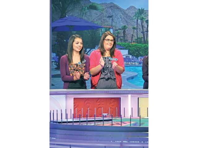"""Ryan Carter and Caitlin Dugger on the set of """"Wheel of Fortune."""""""