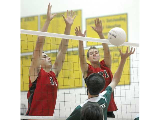 Hart's Taylor Gregory, left, and Tanner Tengberg (21) block a shot by Canyon on Tuesday at Canyon High.