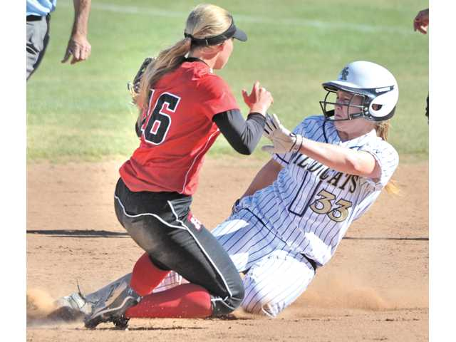 Hart shortstop Juli Strange, left, tags out West Ranch third baseman Lauren Lombardi at second base in the fourth inning at West Ranch High on Tuesday. The Indians won 4-1.