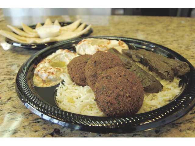 It's a Wrap's vegetarian plate ($7.99) is a satisfying, meat-free feast with a delicious combination of falafel, stuffed grape leaves, rice, hummus, pita and salad or muttabal, an incredible eggplant dip.
