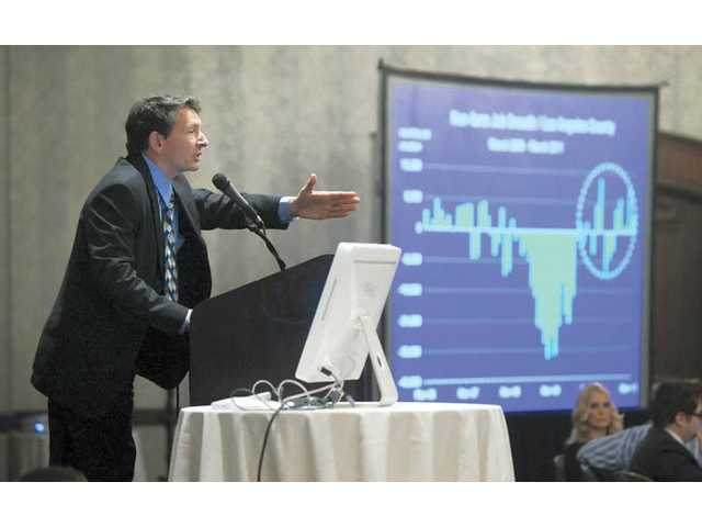 Mark Schniepp, principal of California Economic Forecast, delivers the keynote speech at the 2011 Economic and Real Estate Outlook presentation at the Hyatt Regency Valencia in Valencia on Thursday.