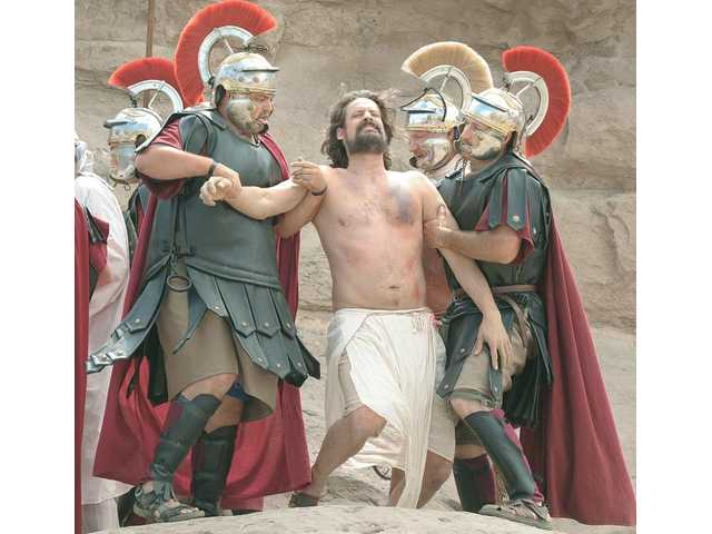"Jesus Christ, portrayed by Aram Granger, center, is arrested and prepared for crucifixion by Roman soldiers during the Easter Passion Play ""A Living Hope"" performed at Vasquez Rocks Natural Area in Agua Dulce on Saturday."