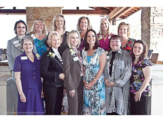 Nominees for the Carmen Sarro Community Service Award take a photo break at the beginning of Zonta's Women in Service ceremony. Shown are (front row, left to right) Maria Sears, Liz Seipel, Julie Benson, Mary Ackerman, Nancy Coulter, Sandra Hardy (back row) Diane Bartley, Deborah Hughes, Donna Kreutz, Kris Hough, Susan Traurig and Amanda Hezel