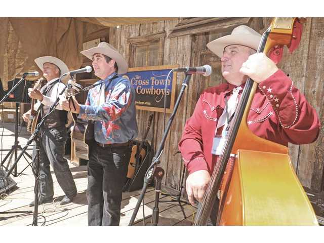 The Cross Town Cowboys, from left, Robby Bausch, Dusty Hart and Buffalo Bryan, perform.