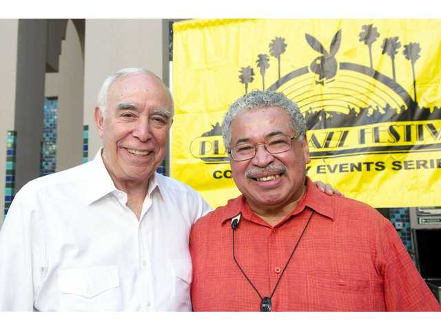 Justo Almario poses for a photo with Playboy Jazz Festival President Dick Rosenzweig.