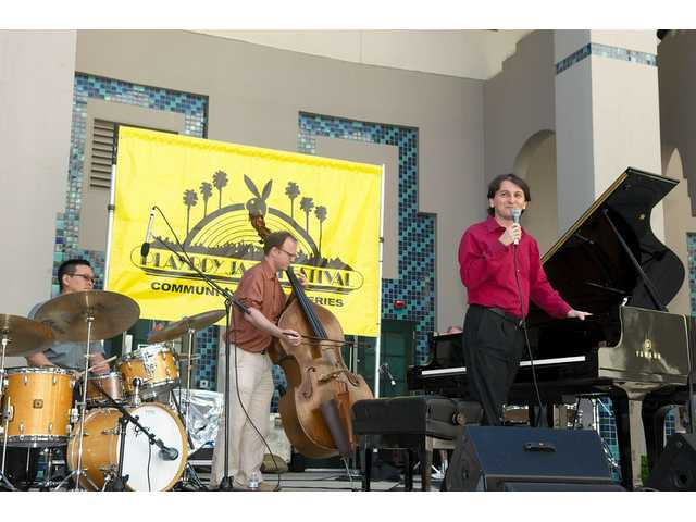 Pianist Tamir Hendelman speaks to the audience at the May 1 Playboy jazz concert in Beverly Hills.