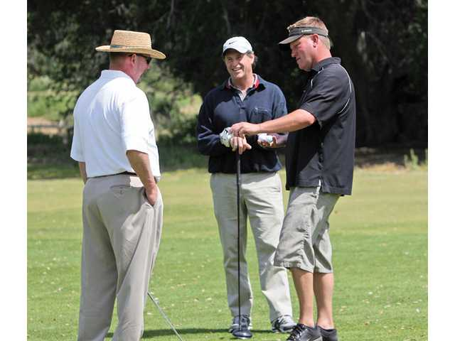 Barry Pontius, Robert Hayis and Randy Sain converse during their golf game at Robinson Ranch Country Club golf course for the 2010 J.R.'s Comedy Club Celebrity Golf Classic last May.