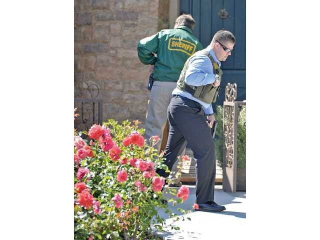 Los Angeles County sheriff's investigators conduct a search for persons initially believed to be burglary suspects on the 26000 block of Shadow Rock Lane in Valencia on Tuesday.
