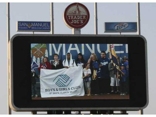 Members of the SCV Boys & Girls Club gathered on the center field warning track as part of the Youth Parade at Dodger Stadium on SCV Dodger Day on May 8, 2010.
