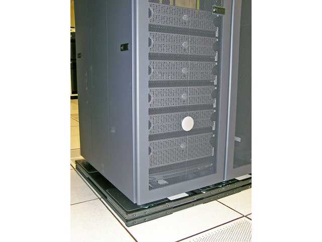 A single rack holding computer sensitive equipment in a data center. The rack sits on an ISO-base seismic mitigation platform, allowing the rack to roll in an earthquake as opposed to shaking violently and damaging sensitive computer equipment.