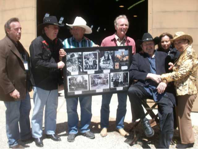 "Pictured at the Melody Ranch Motion Picture Studio Museum are, from left, Daniel Veluzat; Tom White, cousin of ""TV"" Tommy Ivo and creator of the new Ivo and Smith displays; Andre Veluzat and brother Renaud, studio co-owners; William Smith and wife-collaborator Joanne Cervelli-Smith; and Clare Williams, widow of stunt legend Jack Williams."
