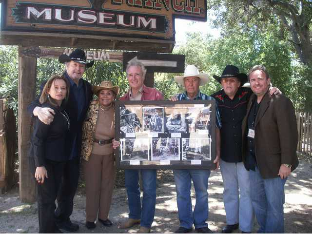 Pictured at the Melody Ranch Motion Picture Studio Museum with part of the museum's new William Smith display are, from left, Joannne and William Smith; Renaud and Andre Veluzat; Tom White, who assembled the display; and Daniel Veluzat.