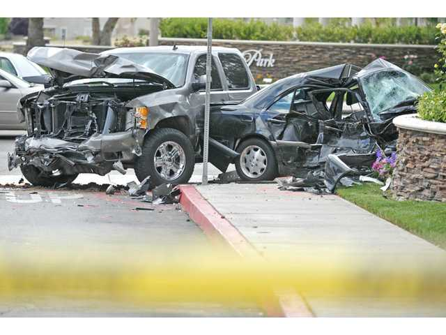 A Chevrolet Silverado, left, and a Mercedes-Benz sedan collided at the northeast corner of McBean Parkway and Summerhill Lane, outside the North Park Village Square shopping center in Saugus on Monday. The sedan driver was in critical condition after the crash.