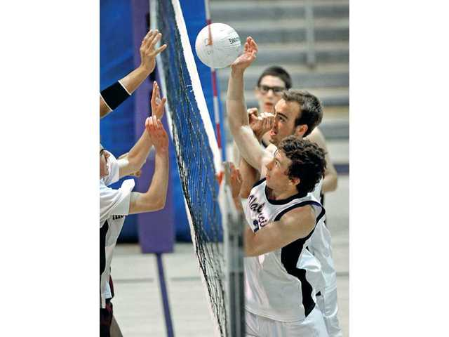 Valencia's Broc Oppler, front right, and Austin Csiszar block the ball during their CIF-Southern Section Division II first-round playoff match against Highland on Tuesday. The Vikings won the match by the score of 3-0.