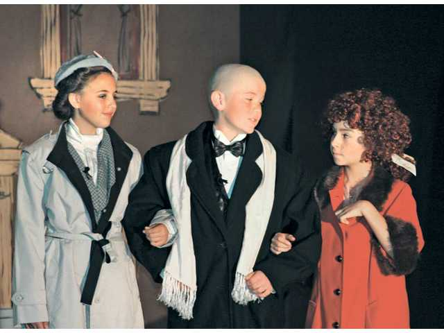 From left to right, Grace Farrell, played by Reece Denmeade, Daddy Warbucks, played by Ethan Ross, and Annie, played by Catie Galan.