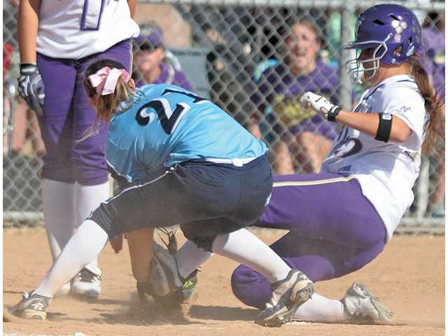 Saugus pitcher AlanNa Layton (21) attempts to make the tag at home plate on Valencia baserunner Maddy Jelenicki (22) as she scores in the fifth inning at Valencia on Tuesday.