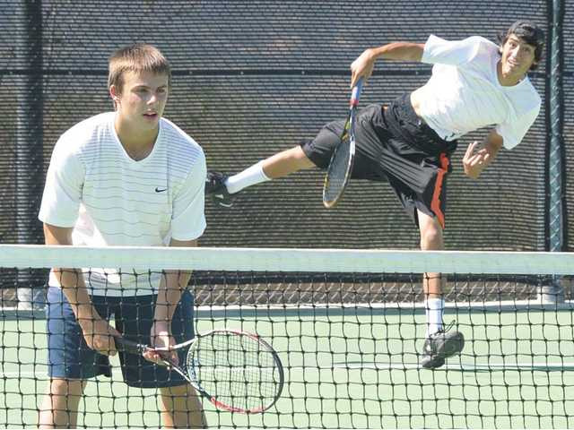 West Ranch doubles player Kiril Lipa, right, serves against La Quinta as partner Evan Abbott awaits the return on Wednesday at West Ranch High School. The Wildcats beat La Quinta 12-6 in the first round of the CIF-Southern Section Division II playoffs.
