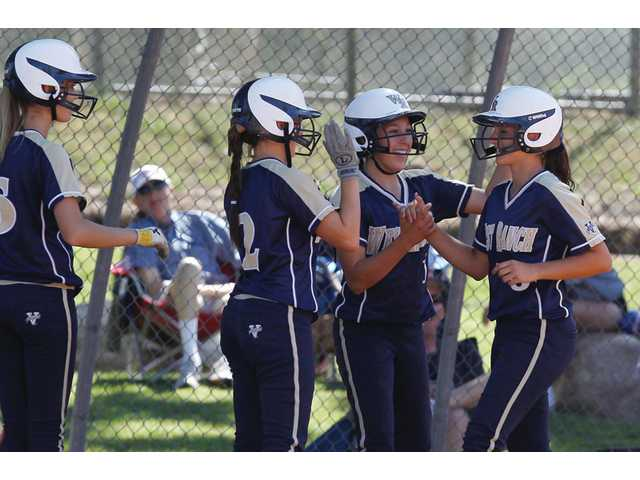 West Ranch's Lauren Lindvall, right, gets high-fives from her teammates after hitting a three-run homer against Hart at Newhall Park on Thursday.