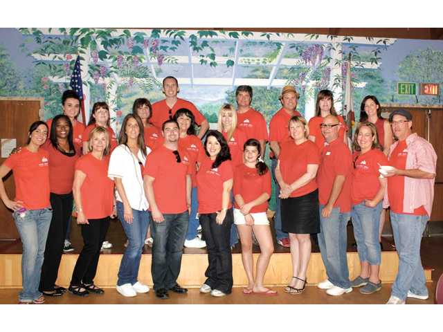 Three hundred agents from the Keller Williams VIP Properties office in Valencia came together Thursday for the company's RED Day event to make a difference with three local charities.