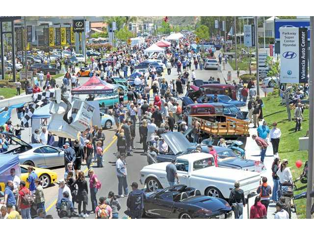 Thousands of people gather on Creekside Road in Valencia for the Gourmet Food Truck Festival and Classic Car Show on Sunday.