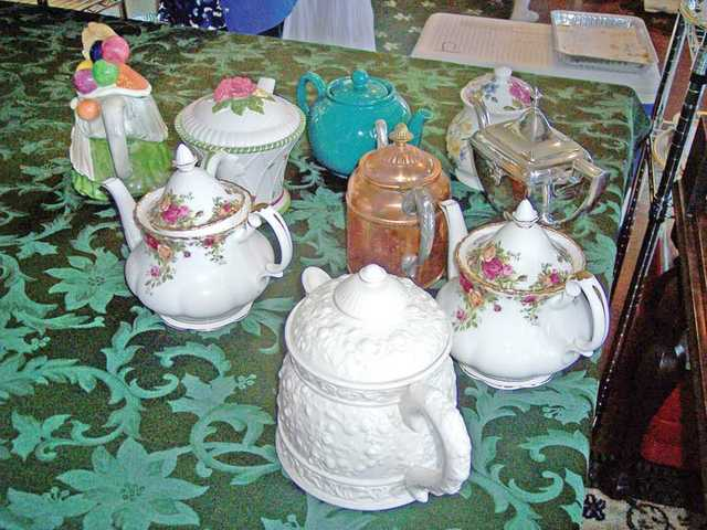 A variety of tea pots were used to serve the 160 guests.