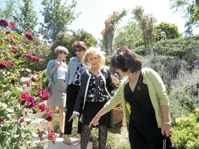 Left to right, Martha Zerella, Ana Mellon, Wendy Hadley and Isabel Shinkarik at the annual Our Lady of Perpetual Help Catholic Church Teabags Tea and Garden Tour.