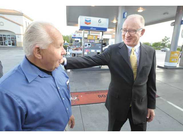 "Rep. Howard ""Buck"" McKeon, R- Santa Clarita, right, chats with Randy Cressall, owner of the Chevron gas station and Auto Spa on Valencia Boulevard, during McKeon's tour of the Santa Clarita Valley on Wednesday."