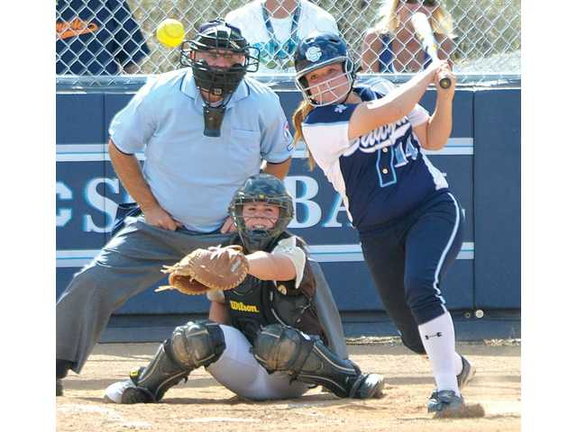 Saugus' Alyssa Rodriguez (14) watches the ball fly off her bat on Thursday at Saugus High during the first round of the CIF-Southern Section Division I playoffs as Canyon of Anaheim catcher Shannon Bustillos looks on.